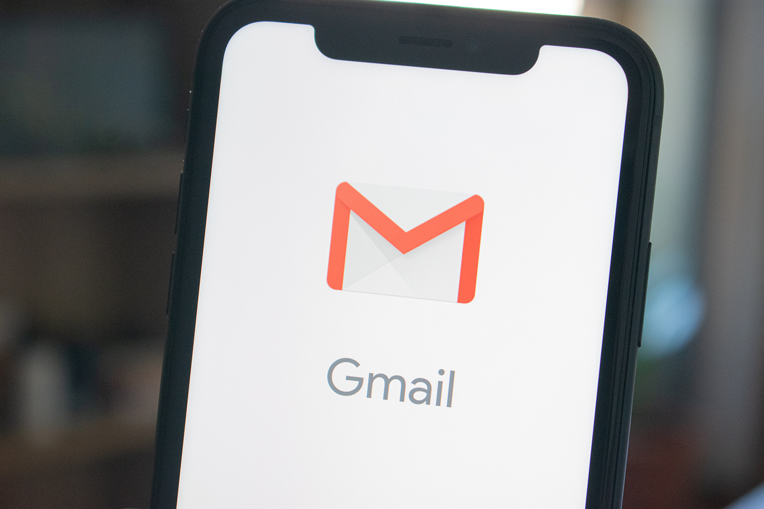 A phone opening the Gmail App