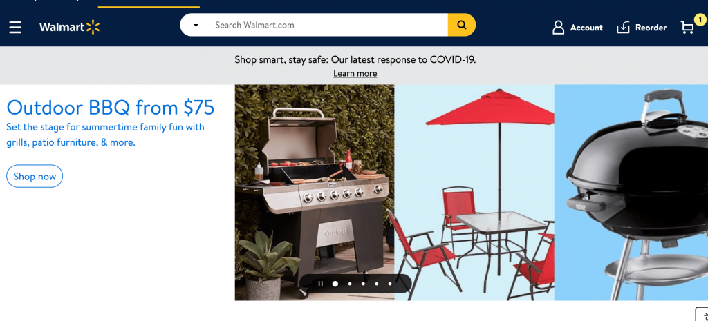 The Walmart Website hero section featuring two grills and an outdoor tableset