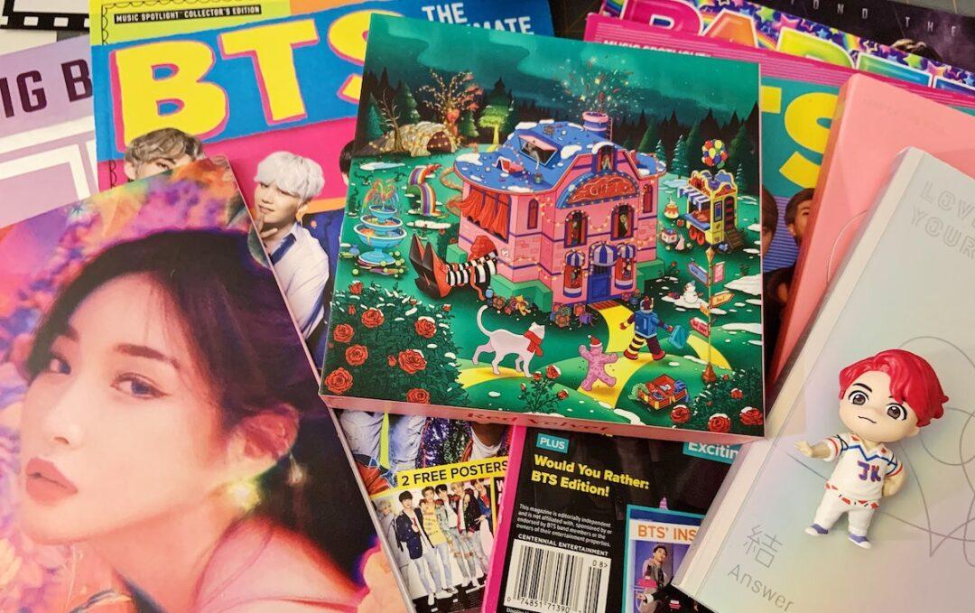 K-Pop merch: books, magazines, notebooks, and figurine