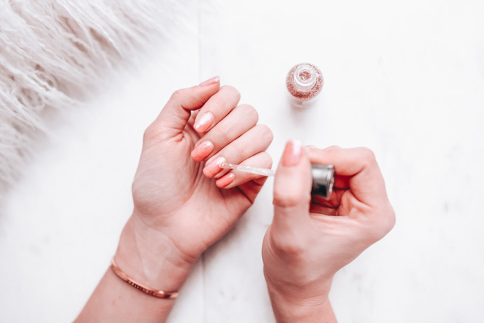 Woman painting her nails. Branding in one day is a bit like painting your nails.