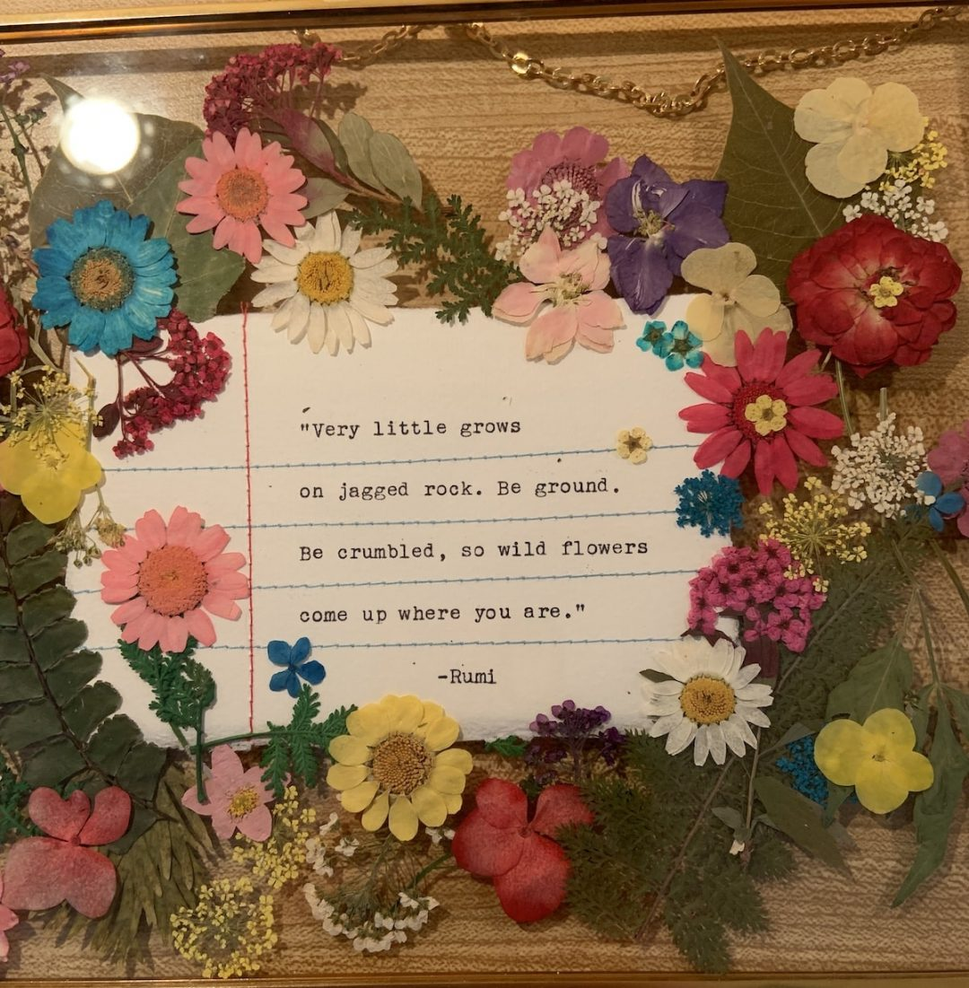 Frame of dried flowers and quote paper